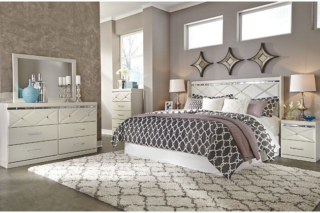 king bedroom furniture set accented with faux white leather and crystal hardware