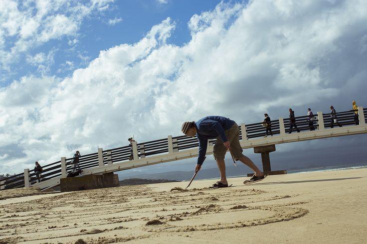 Andrew van der Merwe making sand calligraphy. Photo by josua de vries. #LandArtBiennale #LandArt
