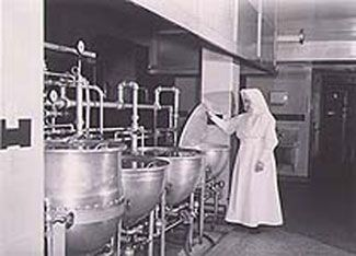 https://library.ndsu.edu/grhc/history_culture/oral/images/hecker4.jpg Sister Reinhardt in kitchen of St. Alexius Hospital, Bismarck, North Dakota.