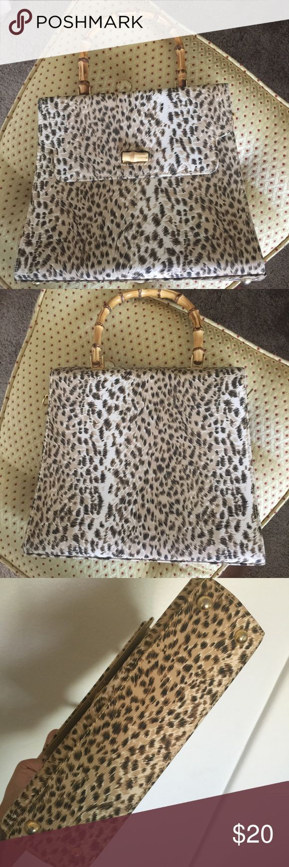 Debenhams leopard hand bag Debenhams leopard hand bag with bamboo handle. Inside has a few marks on it from normal wear but otherwise in good condition. Debenhams Bags Mini Bags