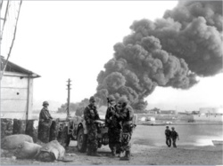 1956: The Suez Crisis, October 29-November 7. Egyptian President Nasser seizes the Suez Canal July 26 to nationalize it. Israeli troops invade the Sinai October 29. British forces take Gaza and Port Said and ultimately recover control of the canal. French paratroopers at Port Said, October.