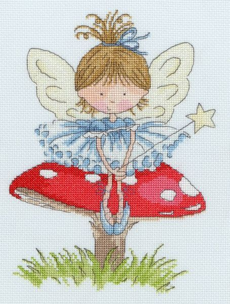 The cartoon toddler in a fairy outfit sitting on a garden toadstool.