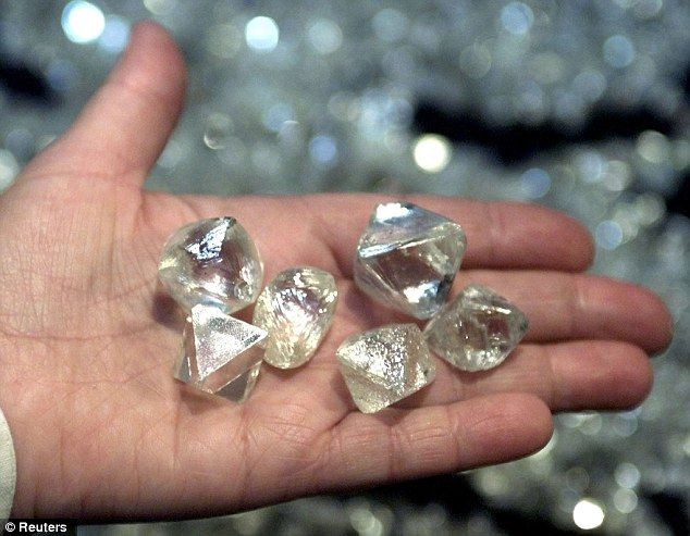 over 50 carats each, were found in Russia's Yakutia mine      Russia reveals vast diamond source under 62-MILE-WIDE asteroid crater which could supply world markets for next 3,000 years