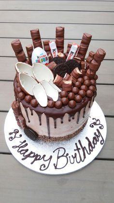 Chocolate overload cake chocolate drip cake ganache kinderegg oreo malteser kinderbueno