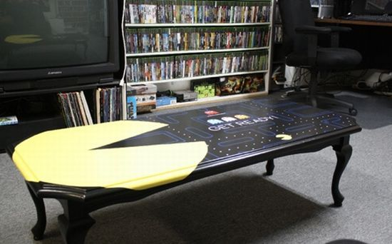 This would work a lot better for me with out the giant Pac Man taking up half the space. But I love the shape of the table and the dark colors. pac-man coffee table #geek #home_decor #gaming