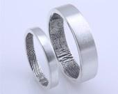 Custom fingerprint wedding bands in sterling silver (set of two). $275.00, via Etsy.