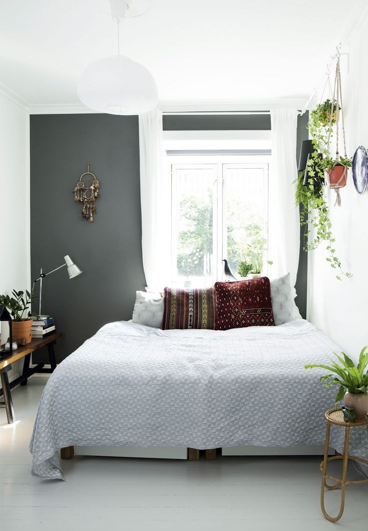 Loving the grey wall and greenery in this space, though I'd go for pure white bedding and some brighter cushions.