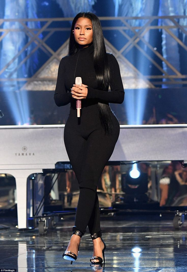 Back in black: Nicki sported a more demure look as she rocked a form fitting top and trousers combination with matching stilettos