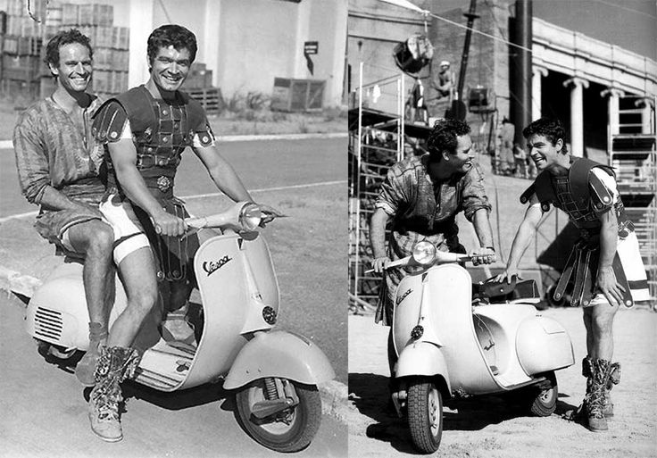 Charlton Heston and Stephen Boyd riding a scooter during the filming of Ben Hur, 1959.