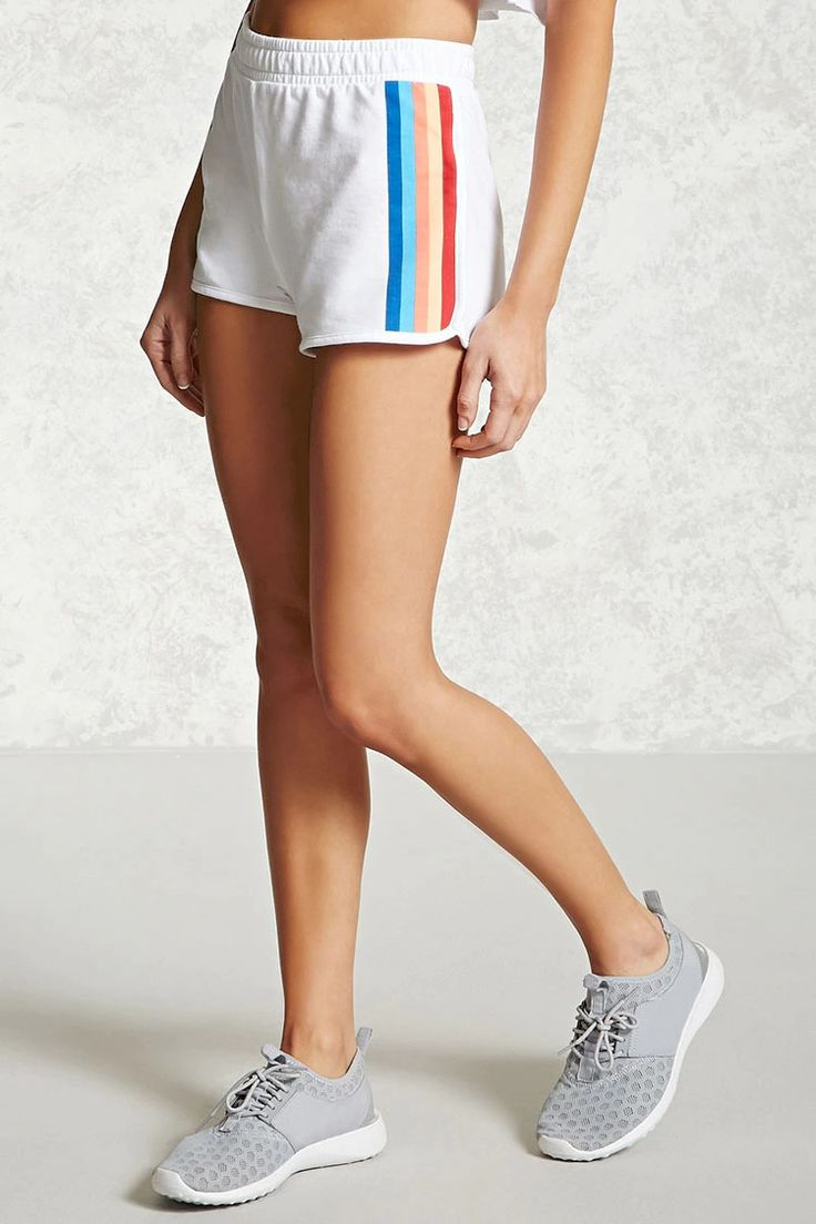 A pair of athletic dolphin-hem shorts featuring multicolor stripes at the sides and an elasticized waist.