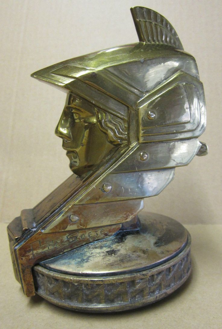 Stylized Minerva, produced from 1930 to 1934.  Made from bronze and silver plated.  Marked P. de Soete.