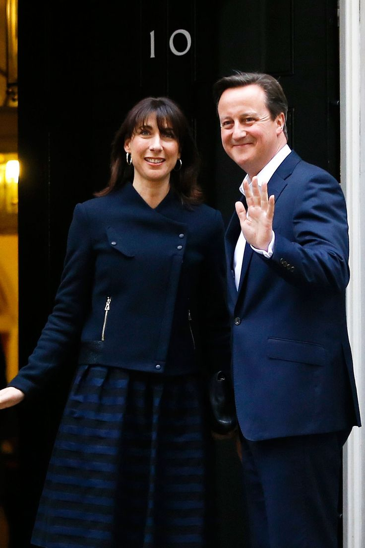 Prime minister David Cameron and his wife Samantha Cameron return to their home at 10 Downing Street in London after Cameron's Conservative party surge ahead in the polls, 8th May 2015. David was in office 2010-2016.