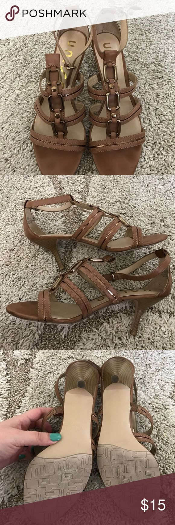 Unisa size 8 1/2 dressy sandal Pre-owned dressy sandal by Unisa. Size 8 1/2 . Small darkening of leather spot on right back sandal. Shown in pic. No scuffing on accented metal pieces. Unisa Shoes Heels
