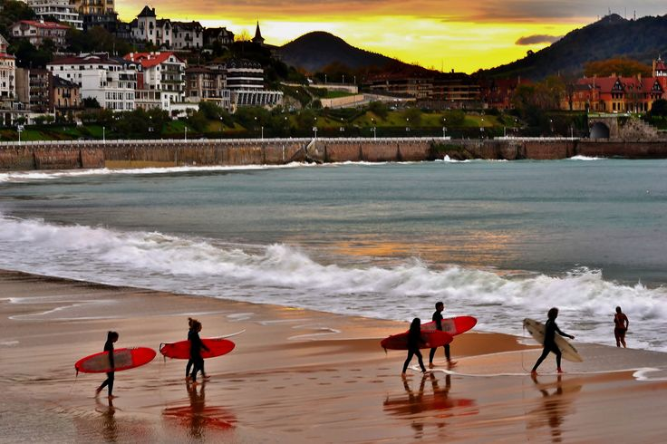 Surfing in San sebastian - I like this because it shows how diverse Europe is in each place. In San sebastian you have surfing and city side by side