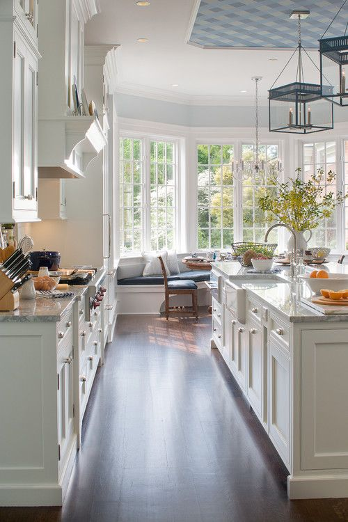 Love - contrast of warm wood floors/ white cabinetry/ marble counters