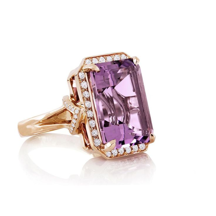 Rose de France and Diamond Pavé After Dark Ring. Exquisite designs with wow-factor appeal entice and inspire the fashionably fearless. Onlookers will cast an envious gaze when they spot you wearing this wondrously iconic ring. Ring features an emerald-cut light Amethyst gemstone with Diamond pavé accents in 18k yellow Gold. || Carelle Jewelry. •$4,900