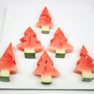 Watermelon Christmas trees! Use cookie cutters to make this easier.