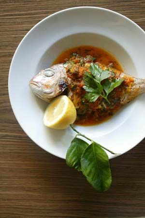 "Orata all' acqua pazza The fishermen of Naples make this dish - snapper cooked in ""crazy water"" - using sea water. I  use sparkling mineral water."