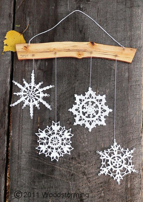 snowflake hanging for a wall, window or anywhere you want.   made of birch wood and white crocheted snowflakes.    selling for 28$ on etsy! need to do with some of Mama's!