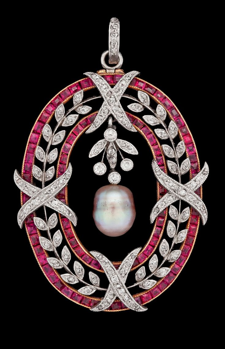 A Belle Epoque ruby and diamond pendant/brooch, circa 1900, composed of gold and platinum with grey pearl. Includes a brooch pin. #BelleÉpoque #pendant #brooch