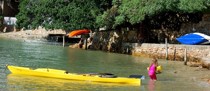 Situated about 500 km from Cape Town, Knysna is one of the Southern Cape coast's best known holiday destinations, huddled between verdant forests and the shores of the wide and breathtakingly beautiful Knysna lagoon. Its most visited attraction is The Heads - the two impressive sandstone peaks standing on either side of the Knysna river mouth.  On the shores of the lagoon, just around the corner from the Eastern Head, lies the Under Milkwood Resort.