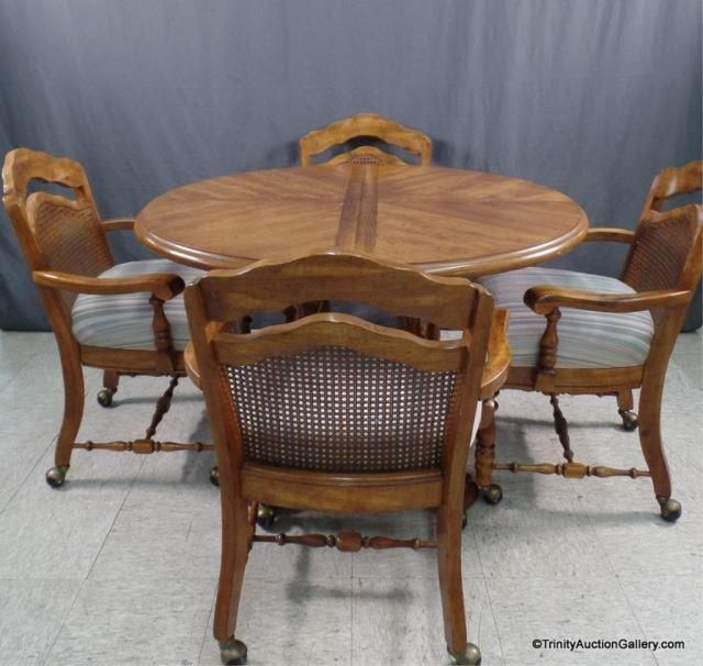 lot 189 round oak dining table with 4 chairs on casters