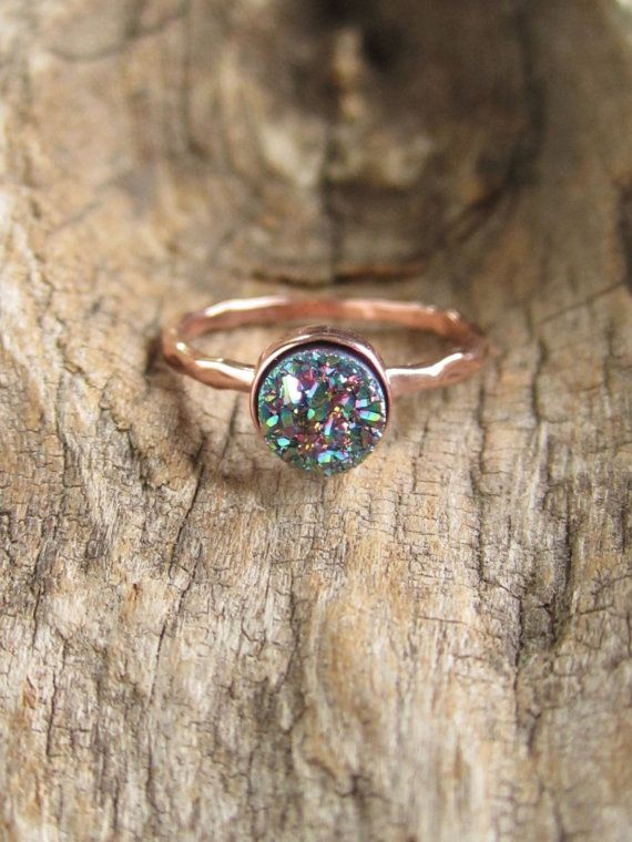 Gorgeous, peacock colored druzy quartz stone is set inside a petite rose gold vermeil hammered ring band. Natural, druzy stone is vapor coated.
