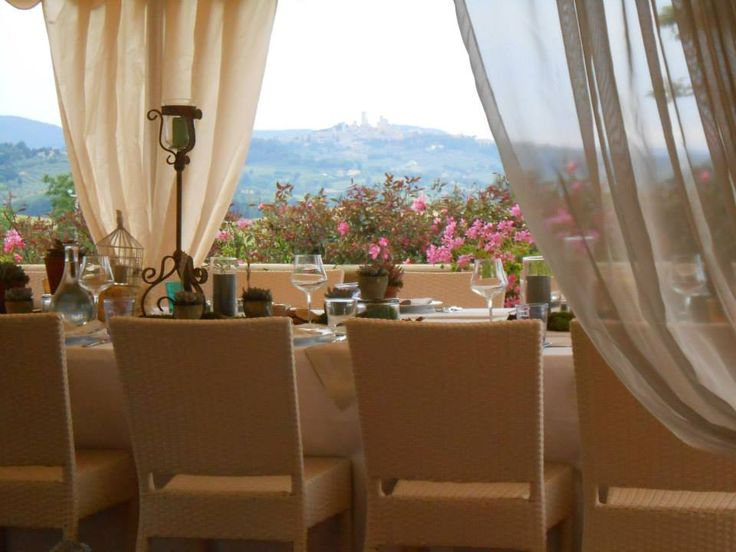 Romantic Wedding in Tuscany in our romantic restaurant near Siena and Florence with stunning view over the typical Tuscan landscape and San Gimignano medieval towers in the background