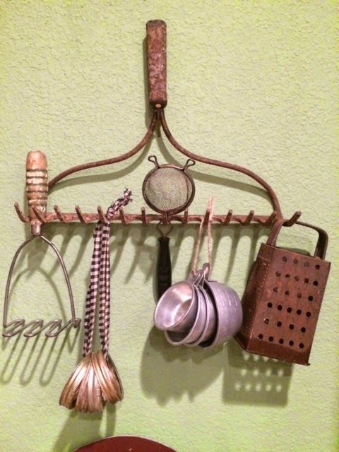 Vintage kitchen utensils, etc., hanging from an old rake head.  The rustier, the better.  Looks great in my kitchen!