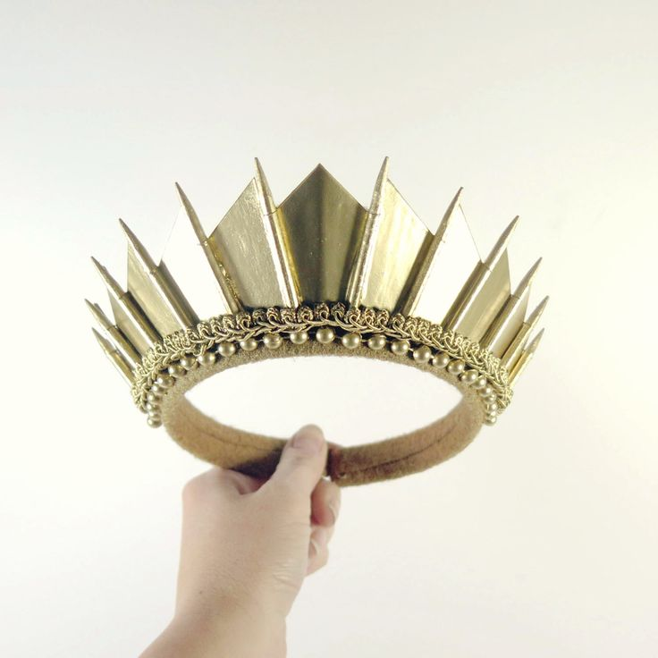 Here it is, the finishing touch to your Burning Man wardrobe/Statue of Liberty costume/birthday ensemble. Carefully crafted in gold, this crown features pointed blades, with delicate trimmings for a t