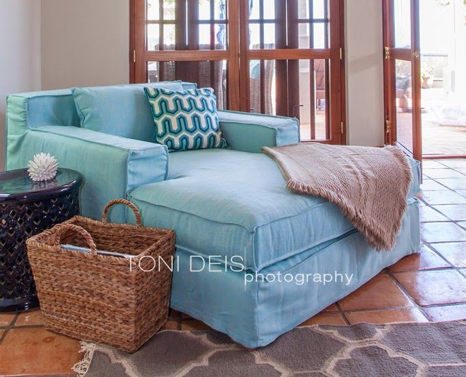 A turquoise chaise for cuddling up with a book, babies, or the fam. House of Turquoise.