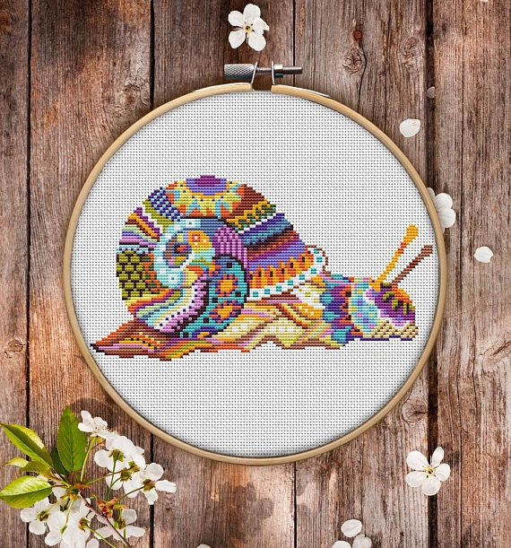 """This is modern cross-stitch pattern of Mandala Snail for instant download. You will get 7-pages PDF file, which includes: - main picture for your reference; - colorful scheme for cross-stitch; - list of DMC thread colors (instruction and key section 8.5x4.5"""" £3.61"""