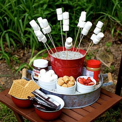 Set up an awesome S'mores station using bucket, skewers, marshmallows etc. It's fun and your guests can make their own using their favourite ingredients.