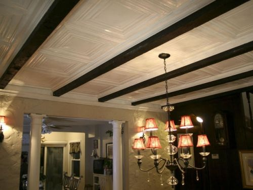 White tin ceiling tiles. So pretty. I really love steel ceiling tiles, but I think they are a bit much. The white tiles with the Craftsman style ceiling beams is a great combo... Stain ceiling beams to match wood flooring