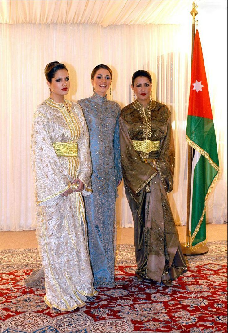 (C) Queen Rania of Jordan receiving Princess Lalla Meryem (R) and Lalla Soukaina in 2002