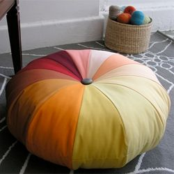 Add a burst of color to your room with this crafty pouf.(via designsponge)