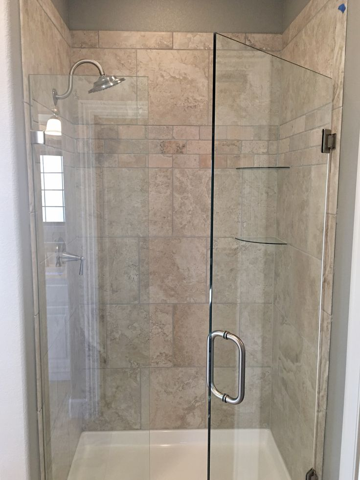 Glass Door Shower With Greige Porcelain And Travertine