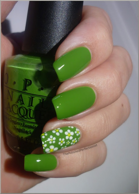 OPI – Green-wich Village, white polish and yellow acrylic paint, dotting tools.