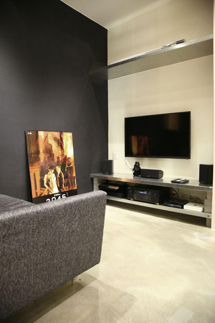 entertainment corner with 2046 movie poster, starwars lightsaber in Hintegro Studio , Hong Kong. interior design. www.hintegro.com