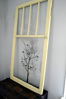 neat way to decorate with old windows-do black tree with colored birds, maybe