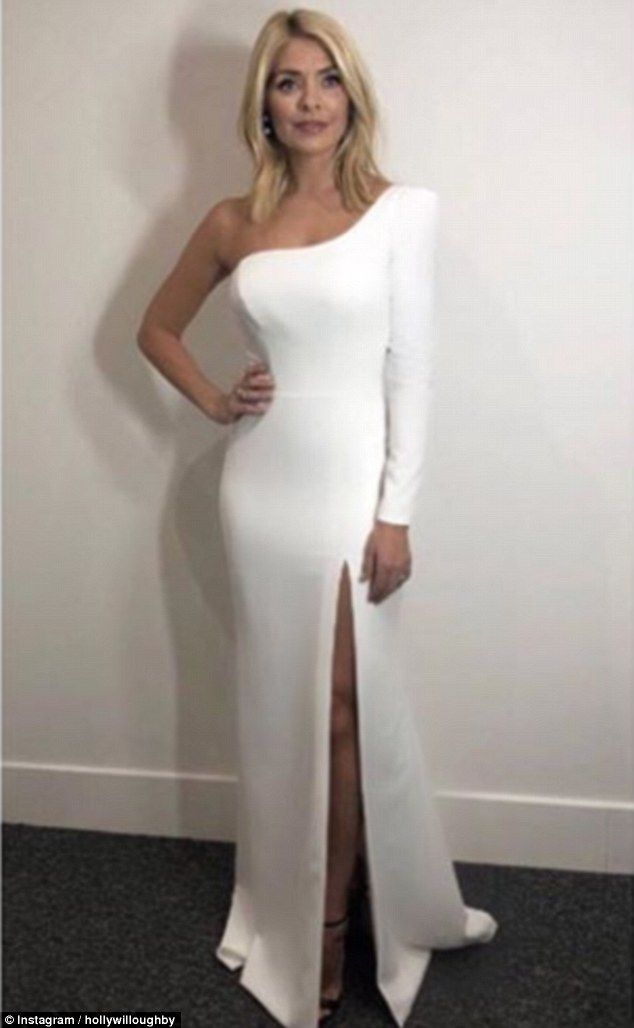 All white on the night: The presenter showed off her incredible curves in the garment...