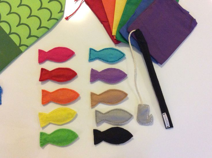 magnetic rainbow colored felt fish with fishing pole game by LittleSpitMonster on Etsy https://www.etsy.com/listing/507225267/magnetic-rainbow-colored-felt-fish-with