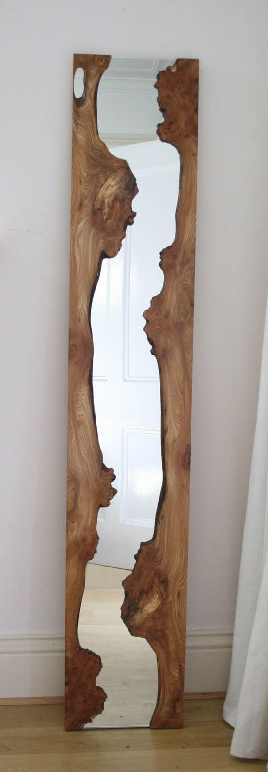 gorgeous wood mirror. Live edges and modern rustic appeal!