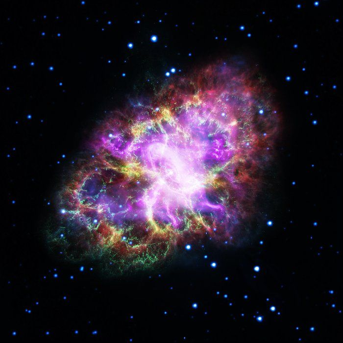 This captivating new image shows the Crab Nebula in bright neon colours. The unusual image was produced by combining data from telescopes spanning nearly the entire electromagnetic spectrum, from radio waves to X-rays. The Crab Nebula, located 6500 light-years from Earth in the constellation of Taurus (The Bull), is the result of a supernova explosion