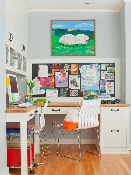 This L-shape desk placed in the corner of the room makes use of potentially wasted space. The layout creates two workzones for multiple users. A magnetic chalkboard wall offers a spot to hang important reminders, calendars, and kids' artwork. The built-in cabinets above the desk provide plenty of space for housing other office necessities.