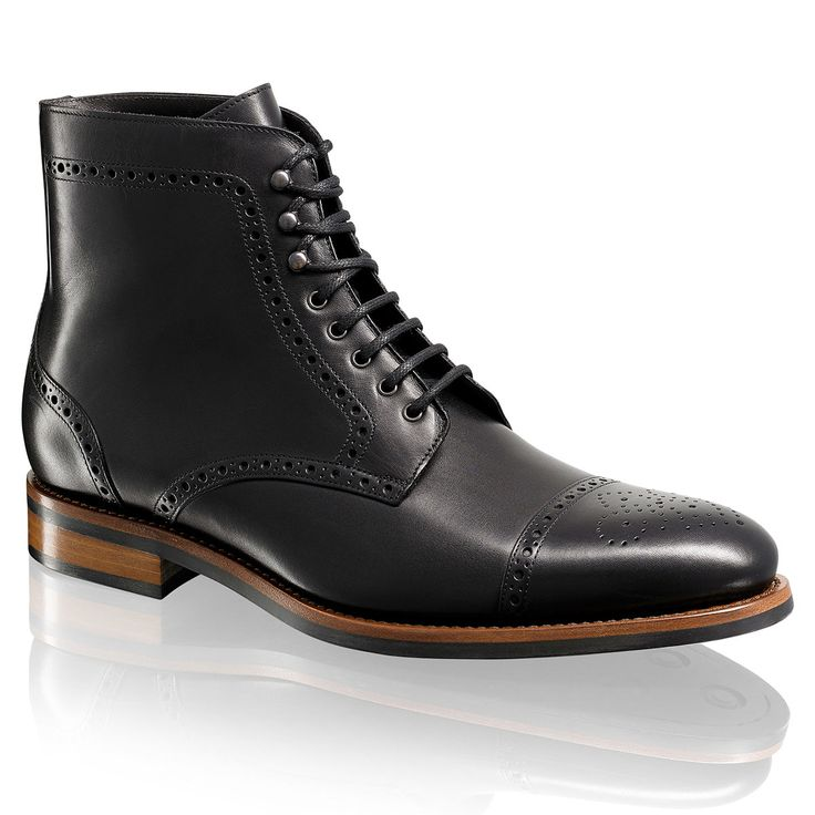 WALNUT Brogue Toe Lace-As a smart boot, Walnut will easily cross formal and informal dress edits. Expertly assembled in Tuscany from black calf leather, this traditional eight eyelet lace-up is trimmed with wing-tip brogueing and a stitched toe-cap. Let the manmade sole provide excellent traction on crisp Autumnal days and style with rolled up selvedge denims.Up-Up -