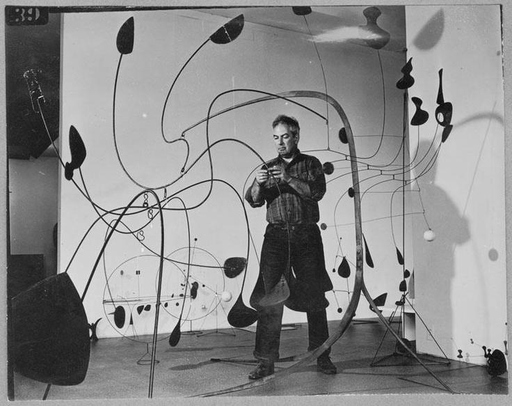 Alexander Calder installing his show at MoMA, 1944. MoMA Archives via installator.tumblr.com