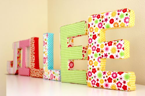 Simple fabric-covered letters tutorial. Paper mache letter, batting, fabric, and hot glue. Some ric rac or embellishments could be fun, too.
