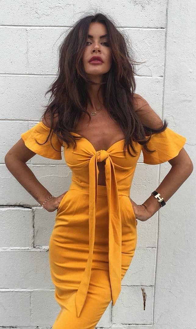 golden girl in off the shoulder with bow detail