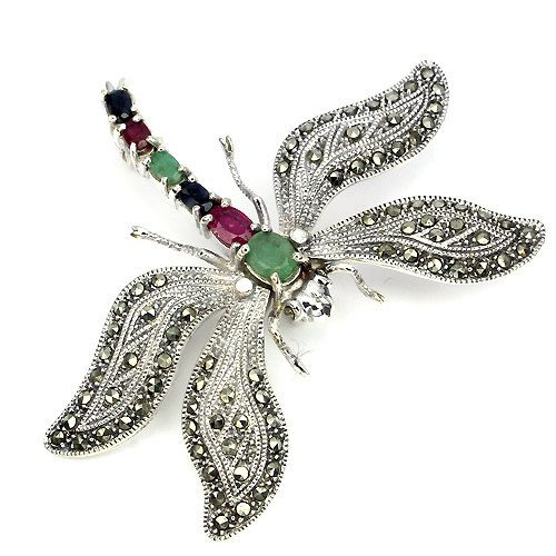 Victorian Naturalism Inspired Dragonfly Brooch With Precious Stones Body and Sparkling Wings That Move as if in Flight ... Stunning  PRECIOUS GEMSTONES:  Top Rich Green natural Zambian Emeralds (7x5mm & 5x3mm oval facet cut) Top Rich Red Pink natural Mozambique Ruby (6x4mm & 5x3mm oval facet cut) Top Deep Blue natural African Sapphire (5x3mm oval facet cut) AAA natural Vietnamese Champagne Marcasite (1 mm round facet cut)  SETTING:  In an Antique finish solid 925 Sterling Silver Victo...